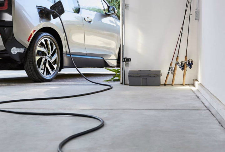 An electric vehicle plugged into a garage outlet.