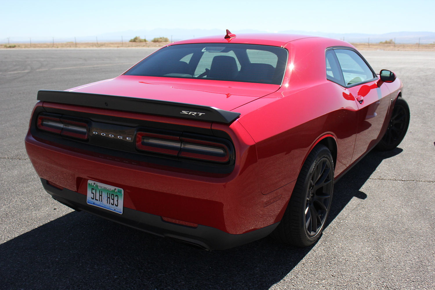2015 dodge charger challenger srt hellcats track review and hellcat on back angle full