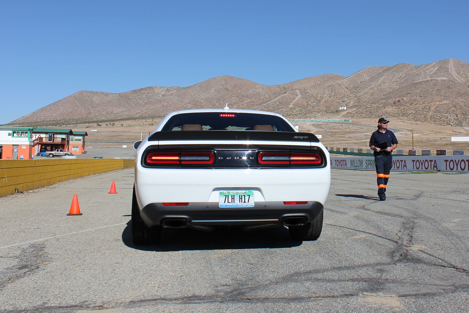 2015 dodge charger challenger srt hellcats track review and hellcat on white back