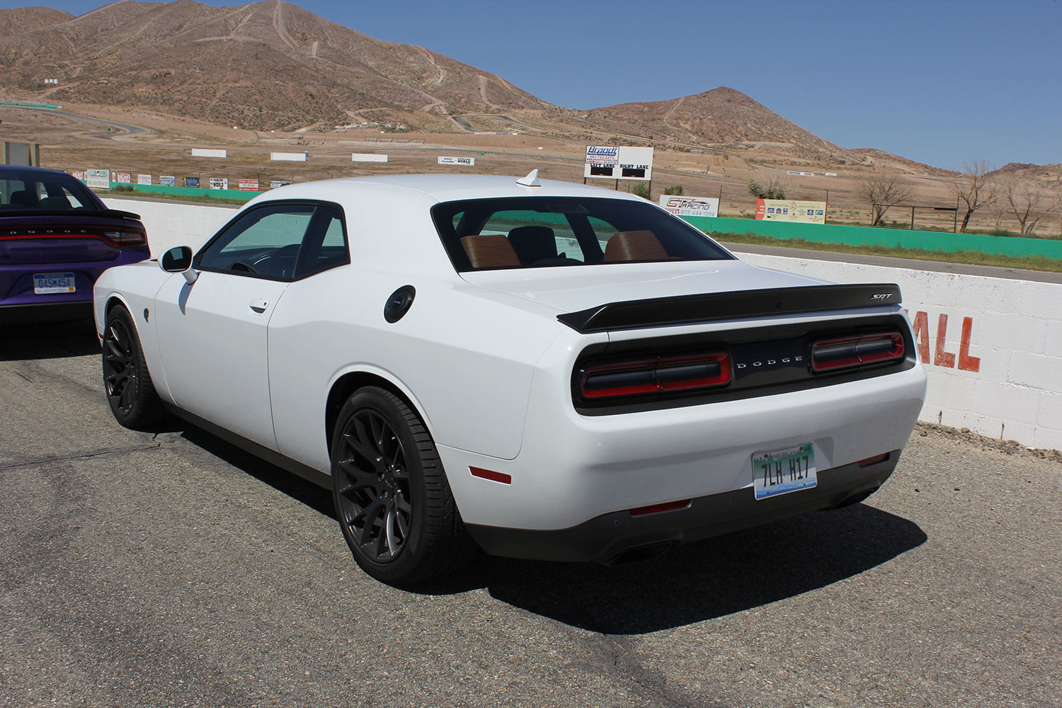 2015 dodge charger challenger srt hellcats track review and hellcat on white top back