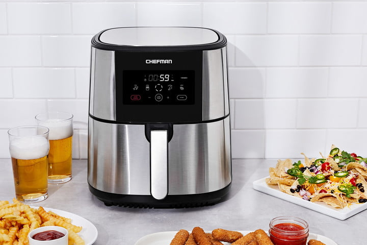 The Chefman TurboFry air fryer surrounded by food that it cooked.