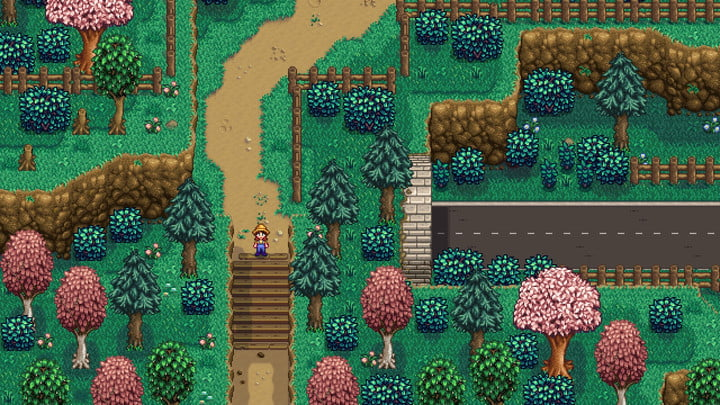 A farmer standing in a forrest.