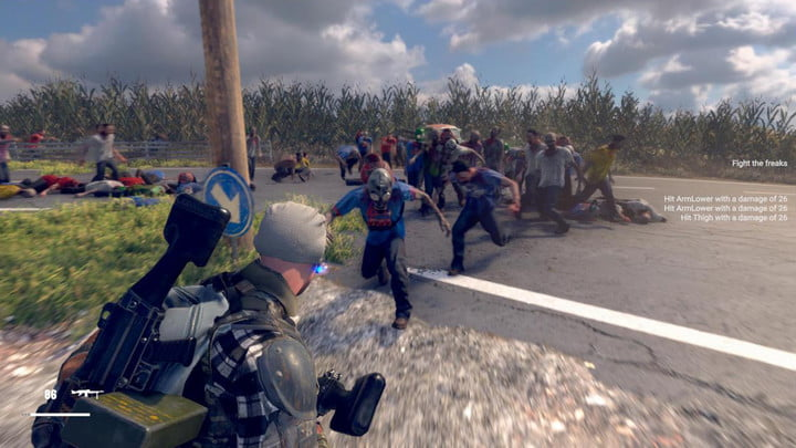 A lone man stands with his gun raised as he is attacked my zombies