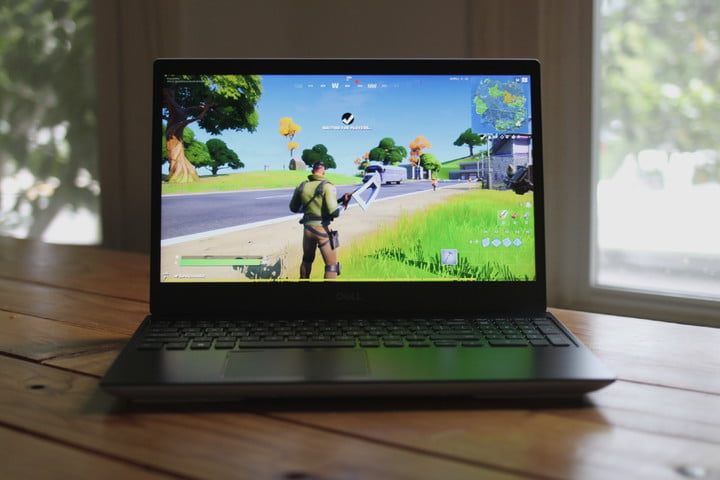 Dell G5 SE gaming laptop review photo. A Dell G5 SE gaming laptop sitting on a wooden table.