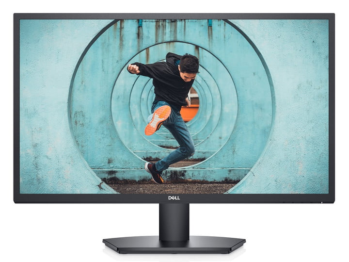 A 27-inch Dell monitor with a man in a dynamic pose on the screen.