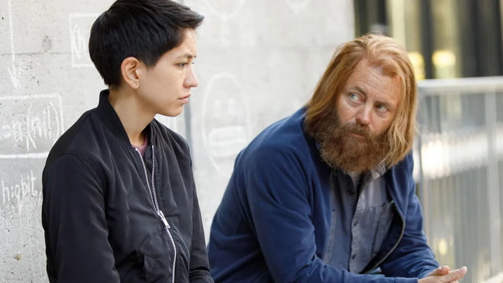 Two characters having a conversation in the movie Devs.