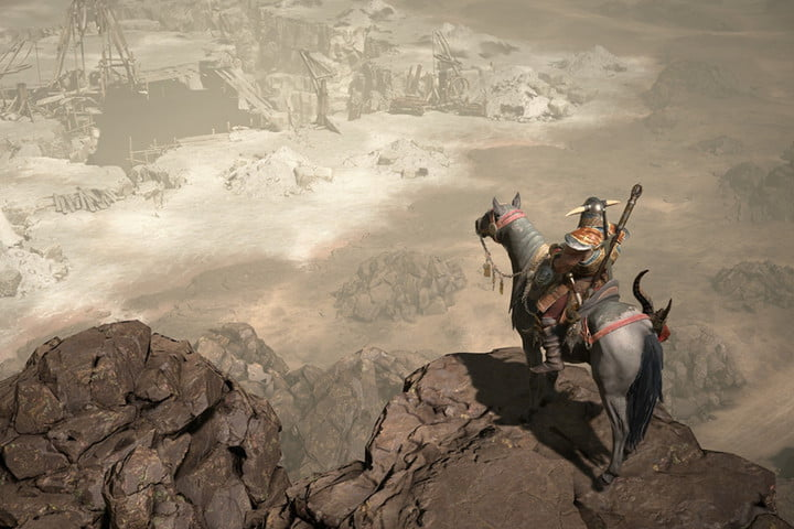 A knight on horseback on the edge of a cliff.