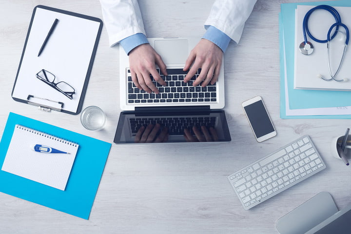 deepmind nhs records legal dispute doctor working at office desk