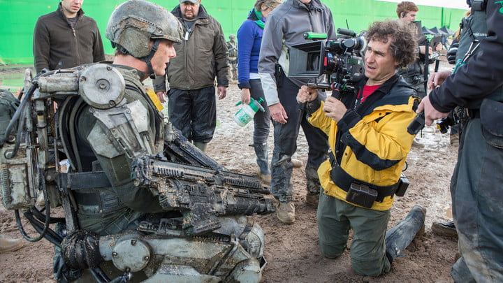 Doug Liman on the set of The Edge of Tomorrow filming actor Tom Cruise's character in the mud