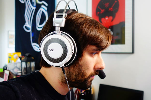 A man wearing the VZR Model One headphones.