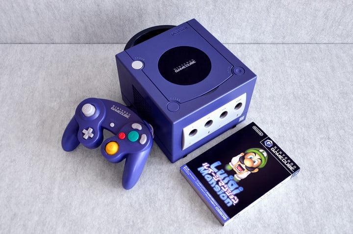 A Nintendo GameCube sits on a table with Luigi's Mansion.