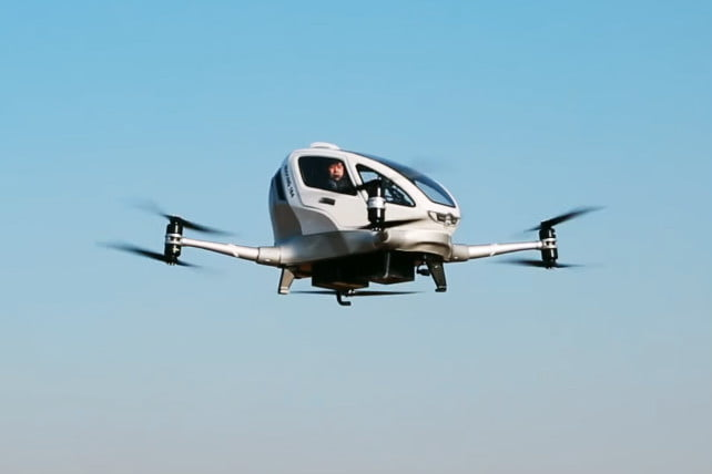 A drone-based flying taxi in midair.