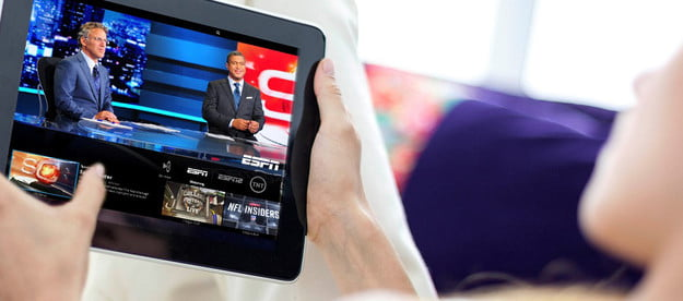 A person watching Sling TV on an iPAd.
