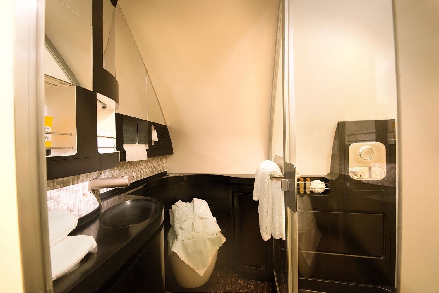 best first class airlines seats etihad airways the residence bathroom