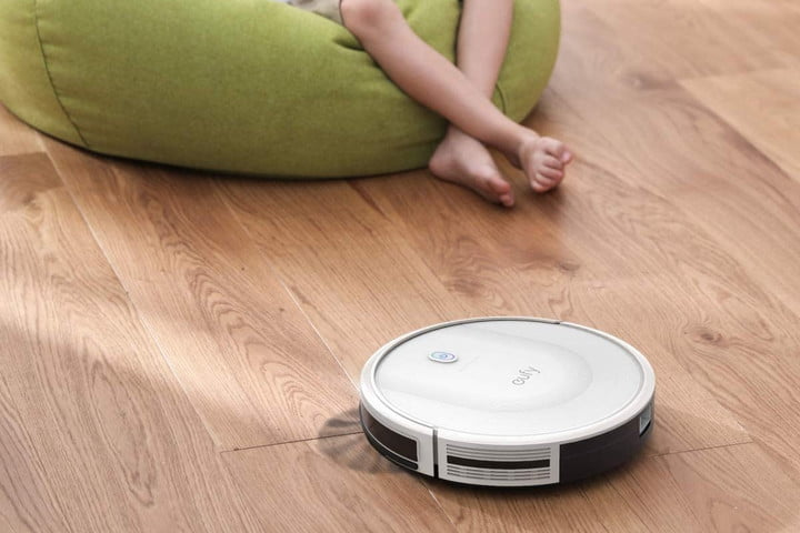 Eufy RoboVac 11S sweeping up the floor with a brush.