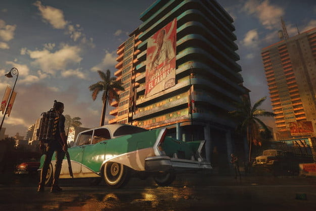 A car and a big building in Far Cry 6.