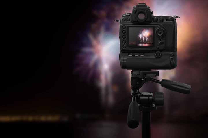 Photograph fireworks by setting up your camera ahead of time.
