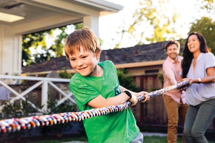 A child playing tug of war while wearing Fitbit Ace 3.