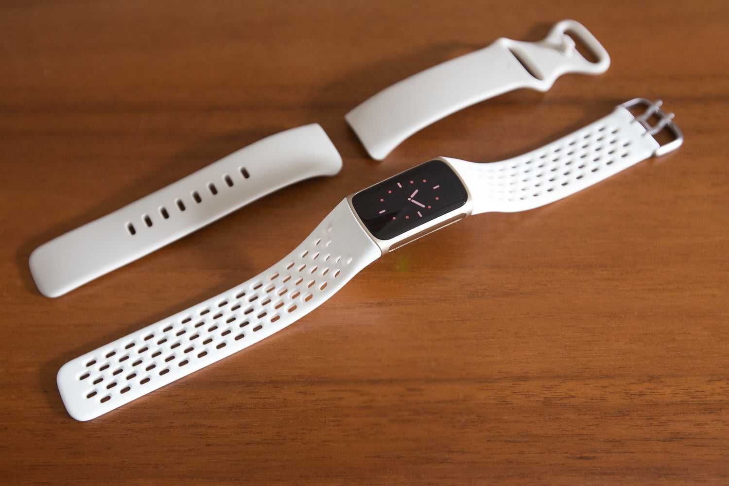 Fitbit Charge 5 standard and sport bands in white.