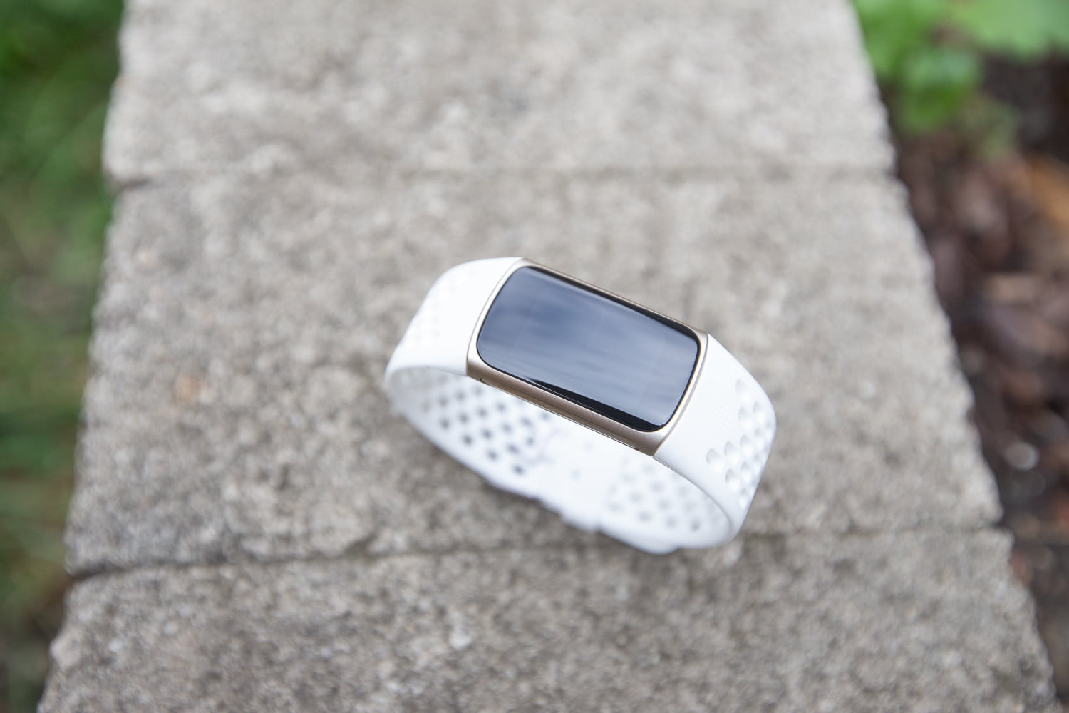 Top-down view of a Fitbit Charge 5 with a black screen.