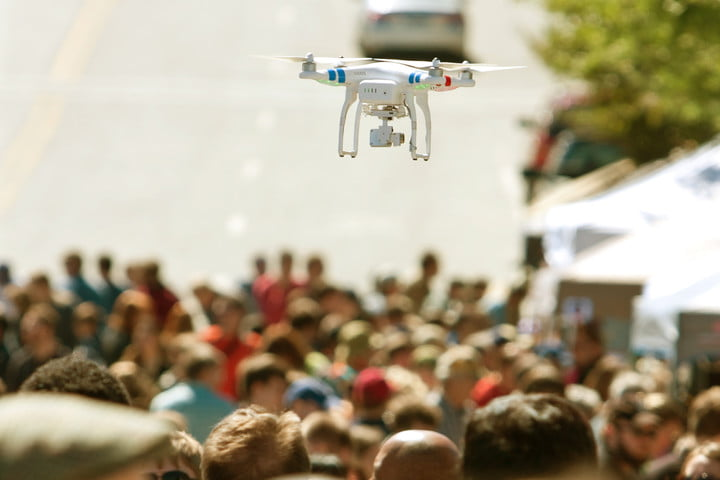 flock drone safety flying hovers over crowd at fair