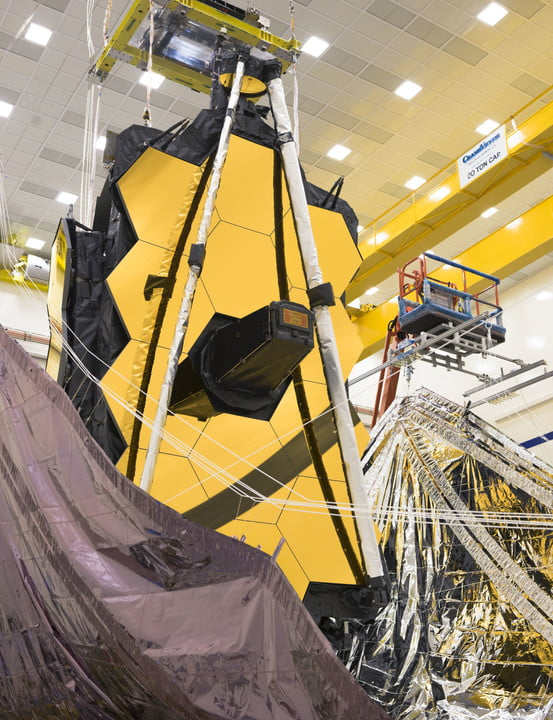 Both sides of the James Webb Space Telescope's sunshield were lifted vertically in preparation for the folding of the sunshield layers.