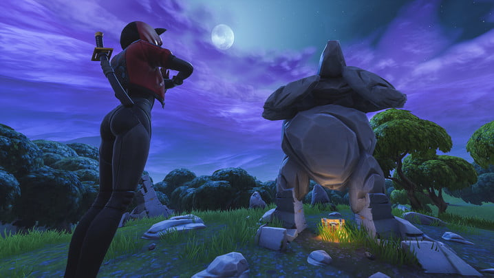 fortnite week 5 challenges search between a giant rock man crowned tomato and encircled tree
