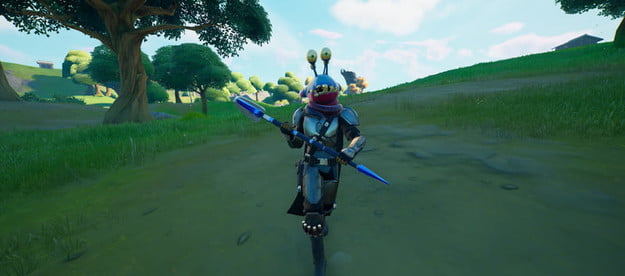 Alien parasite on the head of player in Fortnite.