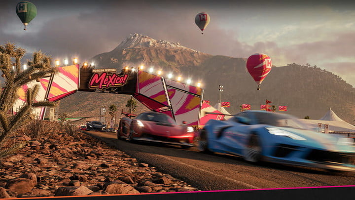 Forza car race with air balloons and banners overhead.