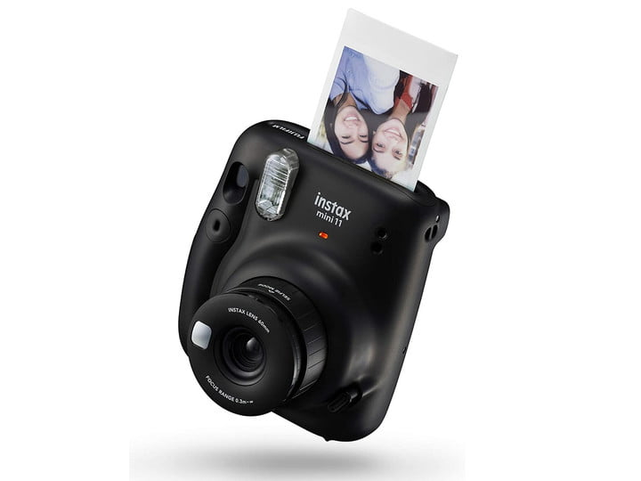 The black version of Fujifilm's Instax Mini 11 while developing a picture.