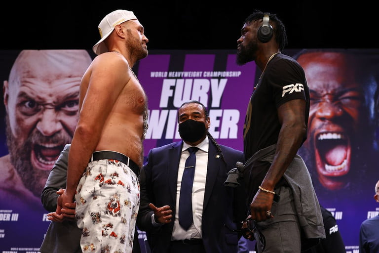 Fury vs Wilder 3 weigh in and face to face picture.