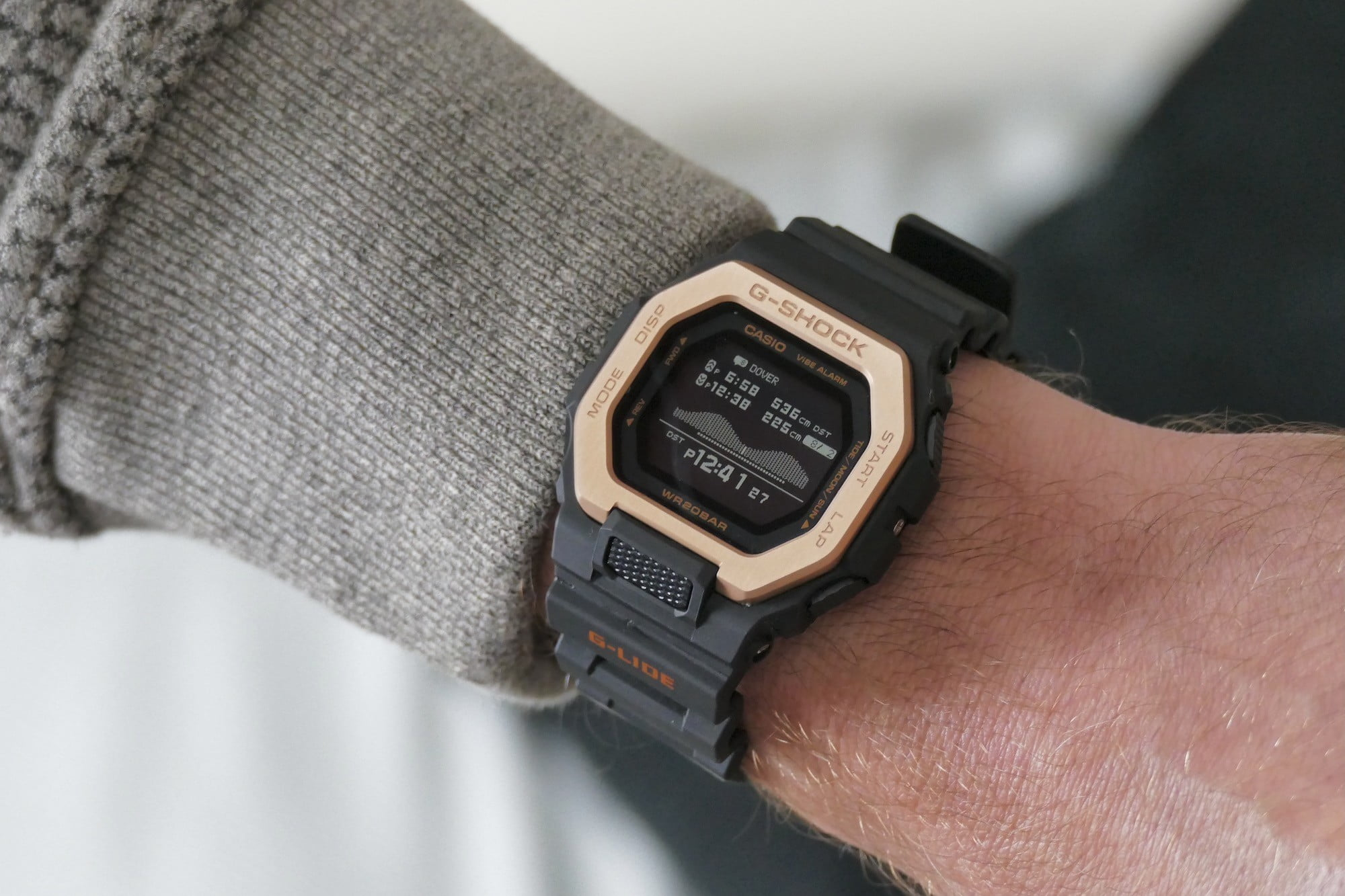 The G Shock GBX-100NS's tide and time screen.