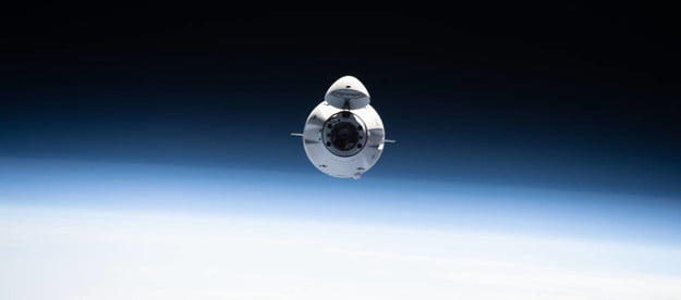 The SpaceX Cargo Dragon resupply ship is pictured approaching the International Space Station June 5, 2021, carrying over 7,300 pounds of new science, supplies and solar arrays to replenish the Expedition 65 crew.