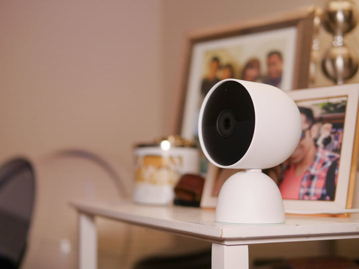 Google Nest Cam (battery) with indoor stand on table.