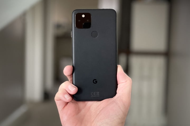 Google Pixel 5 held in hand, seen from the back