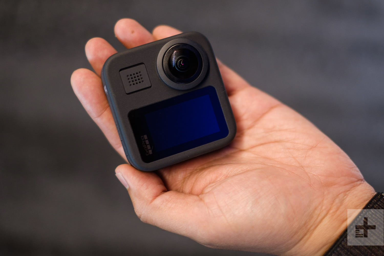 GoPro Max 360 camera in hand, back