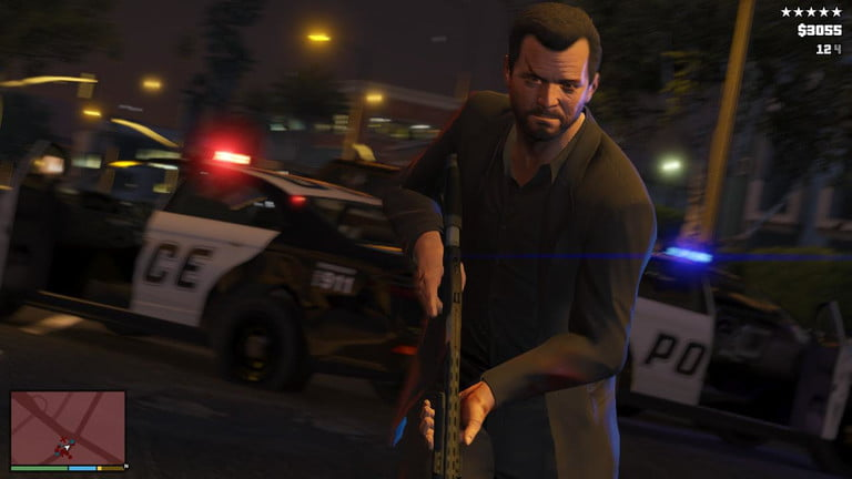 Character holding a gun in front of a police car in Grand Theft Auto 5.