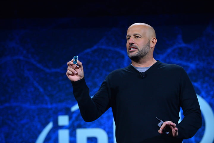 """Gregory Bryant, Intel senior vice president in the Client Computing Group, displays a """"Lakefield"""" reference board during Intel Corporation's news event at CES 2019 on Jan. 7, 2019, in Las Vegas."""