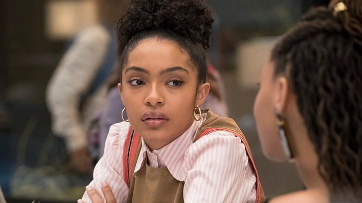 Zoey from Grown-is sitting in class.