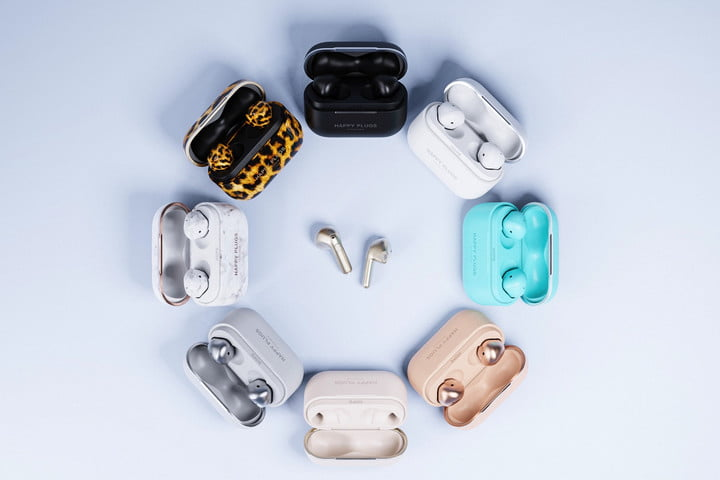 Happy Plugs Hope earbuds shown in a variety of colors.