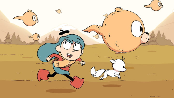 A scene from the animated series Hilda featuring the title character running through a field.