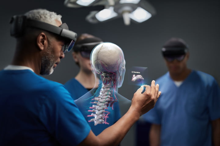 surgeons wear Hololens 2 headsets in the OR