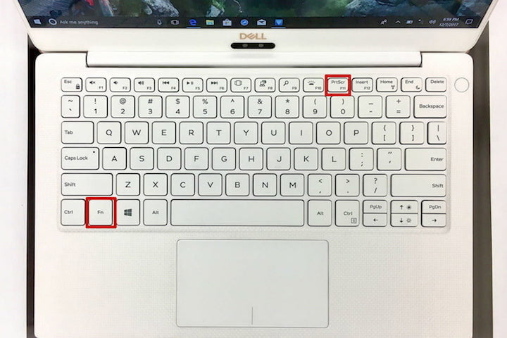 A bird's-eye view of a Dell laptop's keyboard with the Print Screen and Function keys outlined in red boxes.