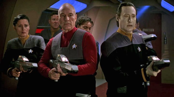 Captain Picard, Commander Data, and other crew in Star Trek: First Contact.