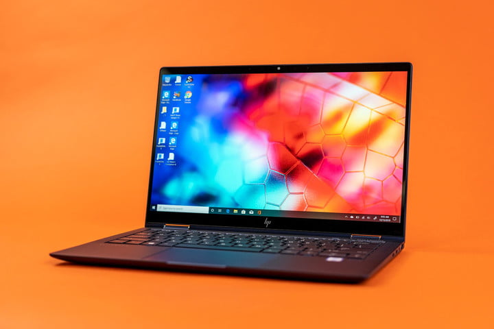 HP Elite Dragonfly review photo. An HP Elite Dragonfly laptop sitting on a bright orange background.