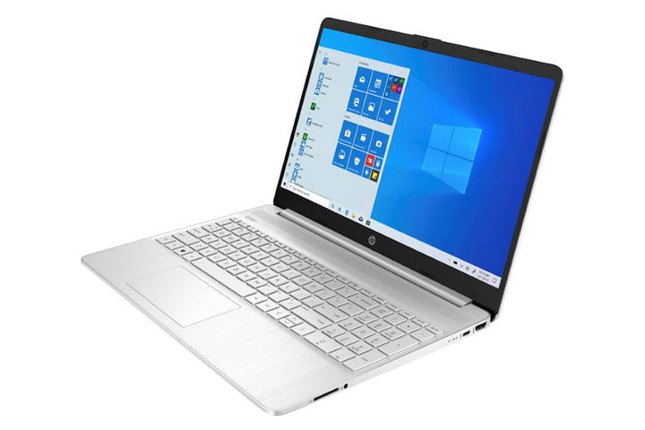 A silver laptop from HP with the Windows home screen on the display.