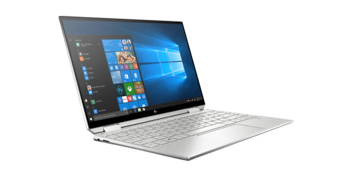 An HP laptop with the screen open.