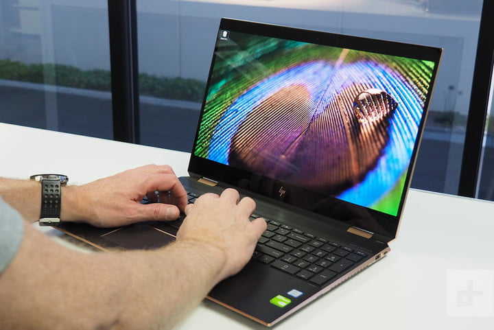 A person typing on the HP Spectre x360 14.