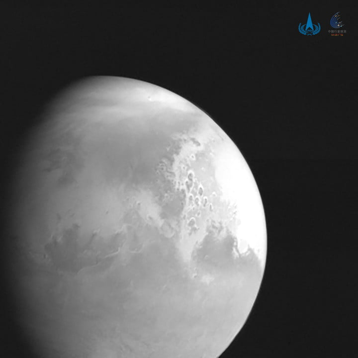 A black-and-white picture of Mars taken by Tianwen 1, the first snapshot from the Chinese craft.