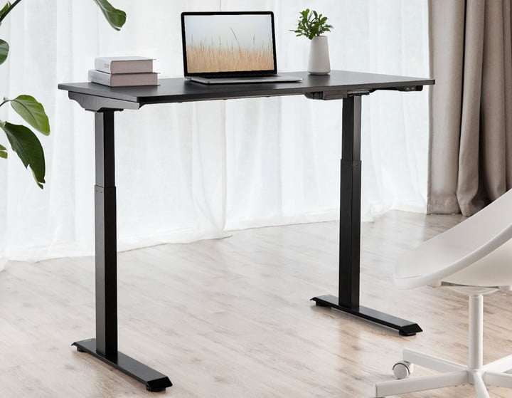 A laptop on the Insignia Adjustable Standing Desk.